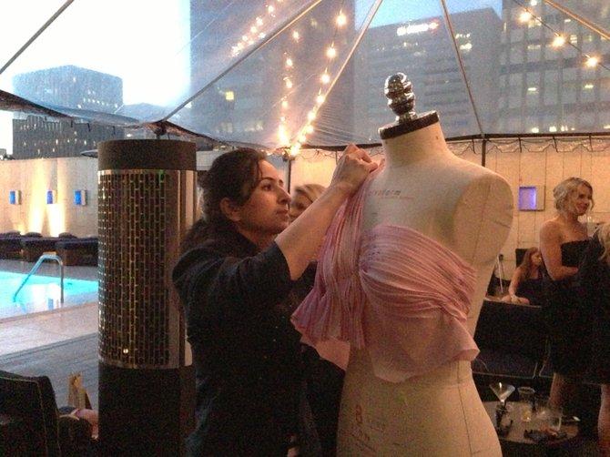 Shailaja working on her dress