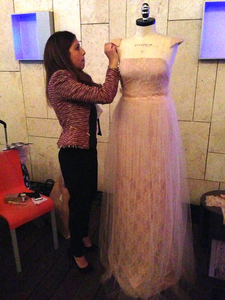 Ana puts finishing touches on her dress