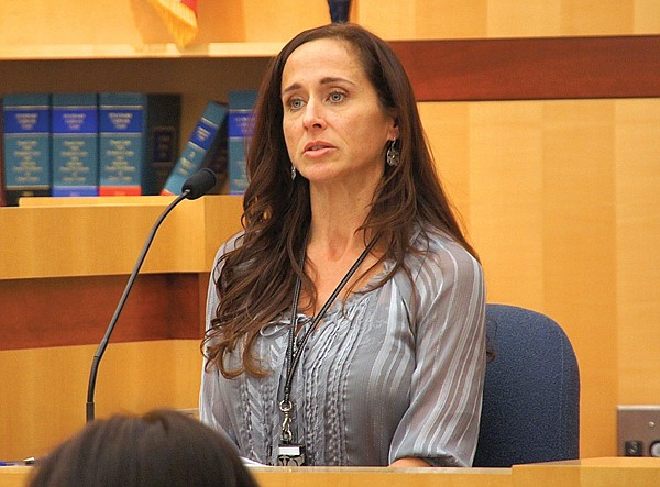 Oceanside police detective Karla Williams arrested Difrancesco after the latter left a bag of jewelry with a bail bondsman.