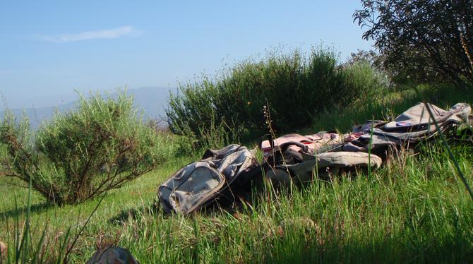 Discarded backpacks near the border