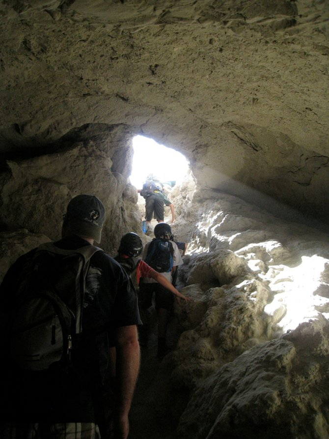 "Climbing out of an Anza Borrego ""Mud Cave."" (photo by Andrew Accardi)"