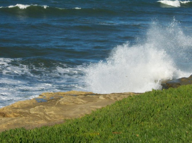Large waves batter Sunset Cliffs in Ocean Beach.
