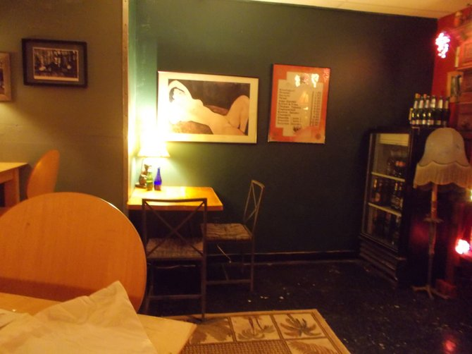 Candles, lamps and art make Kafe Saboka's intimate bar area feel like a kinda salon right out of Eastern Europe.