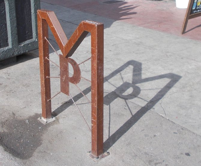 Metal sign outside Monkeypaw is a good place to lock your bike