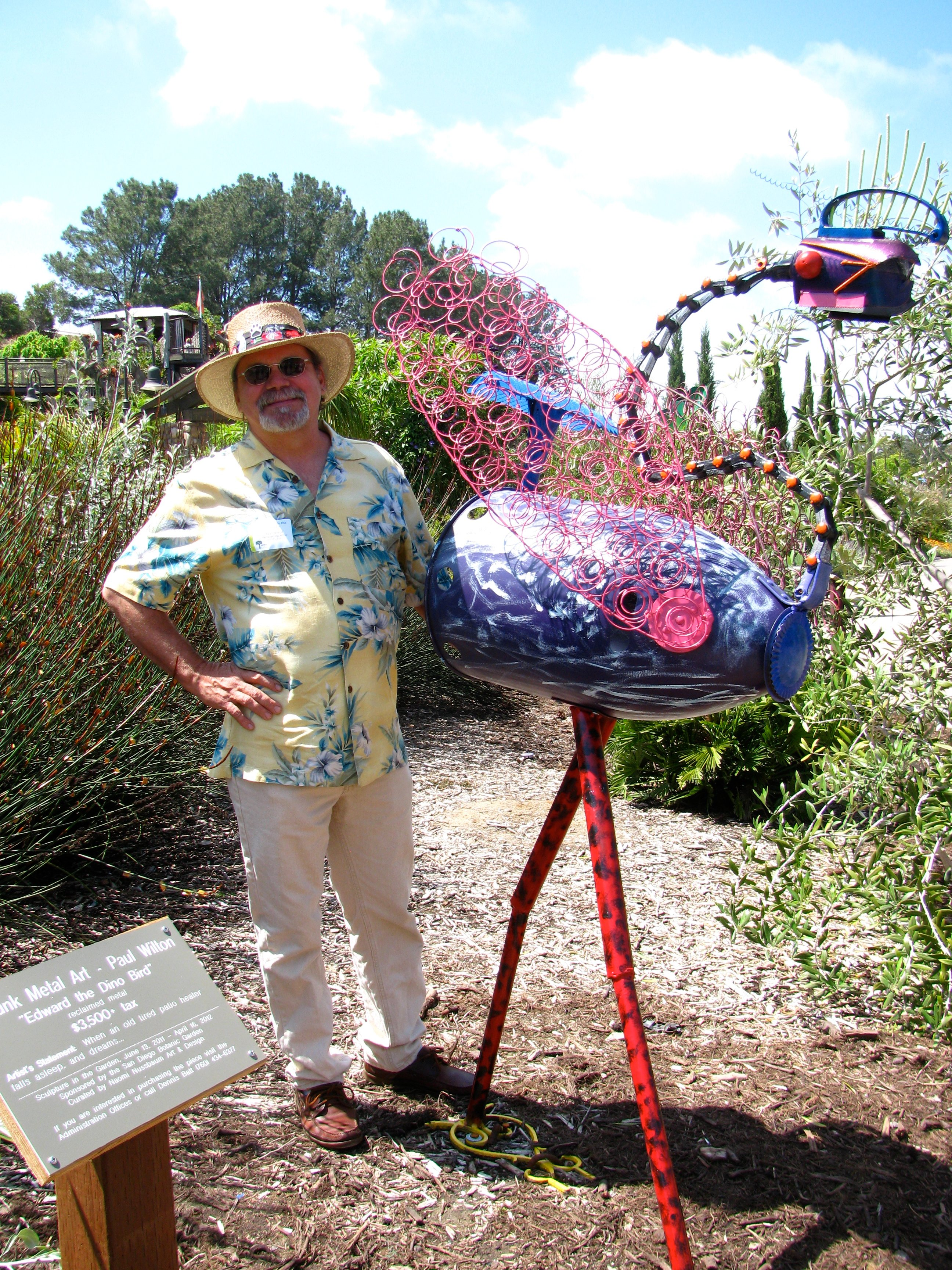 "Paul Wilton and his sculpture ""Edward the Dino Bird"""