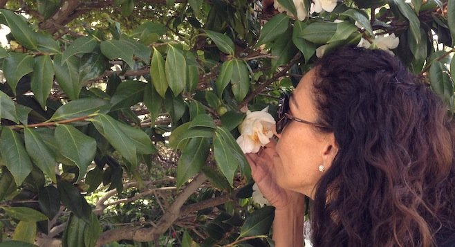 Jane stops to smell a flower