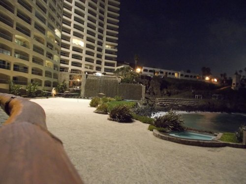 Las Olas's beach and pool and waterfall, by night