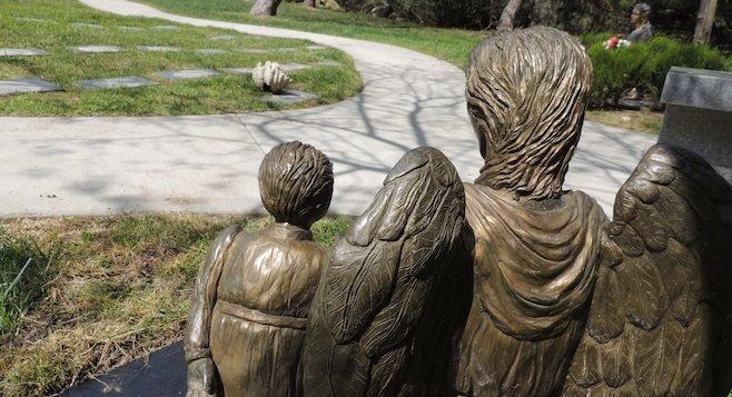 "Carole Lee's hand-sculpted bronze statue, ""Gloria's Love"""