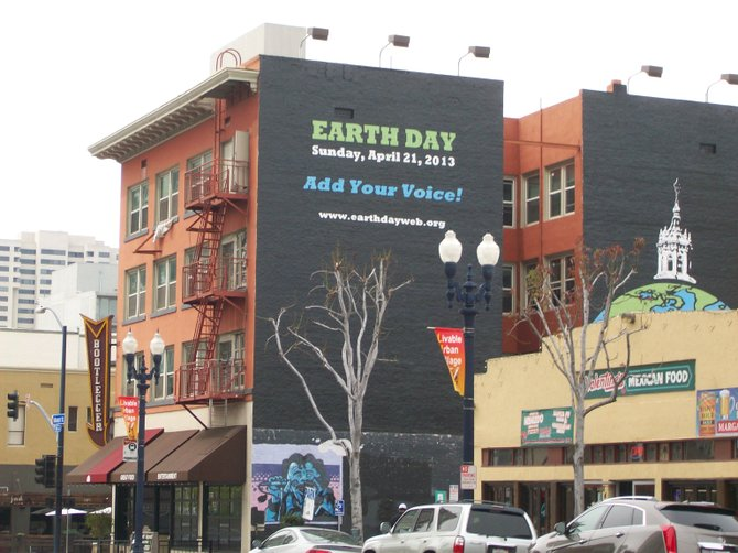 Earth Day advertisement along wall in East Village.