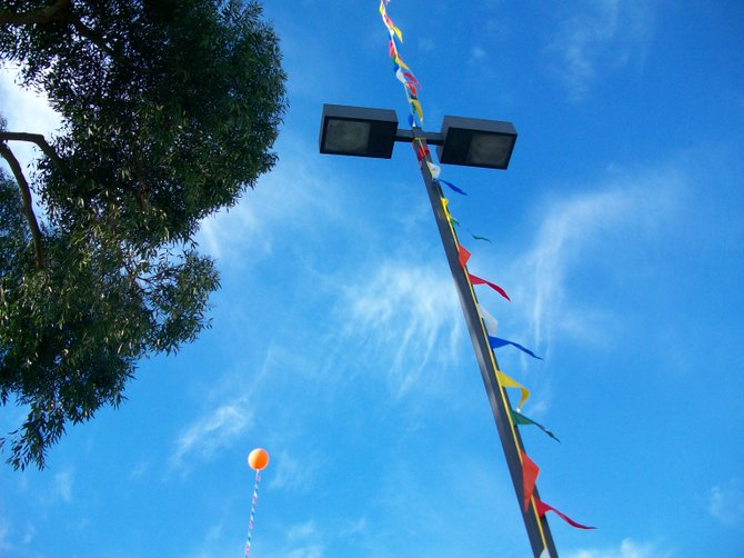 Balloon and flags flutter outside the new Grocery Outlet in Pt. Loma.