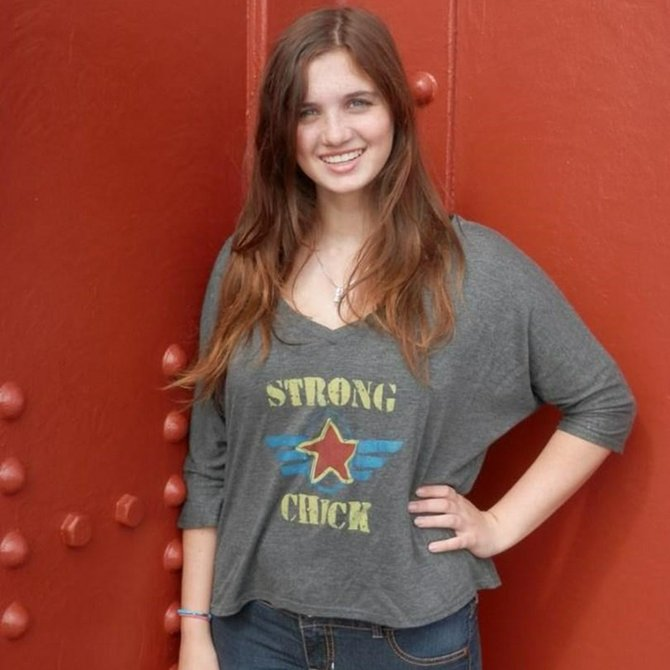 Ally Boulas, of Sacramento, modeling her shirt that won a contest. $5 from each sale will go to Operation Homefront.