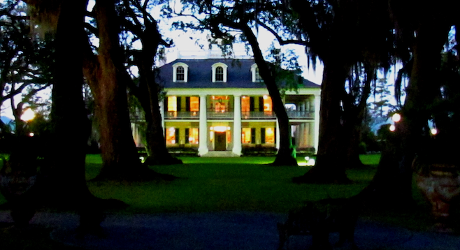 The grand Houmas House at dusk on the bayou.