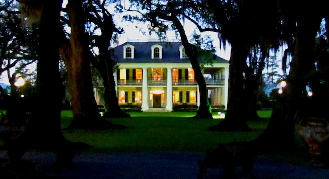 The grand Houmas House at dusk on the bayou.