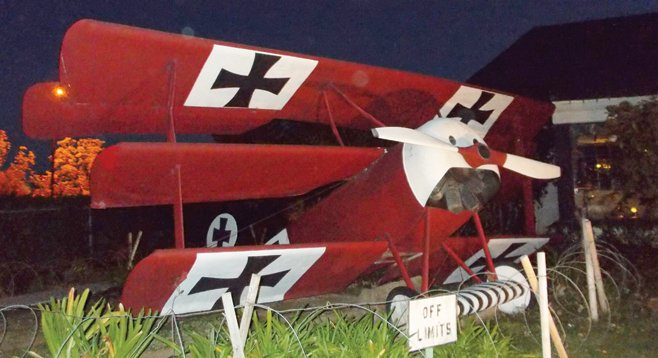 A replica of the Red Baron's Fokker triplane sits outside 94th Aero Squadron alongside Montgomery Field in Kearny Mesa.