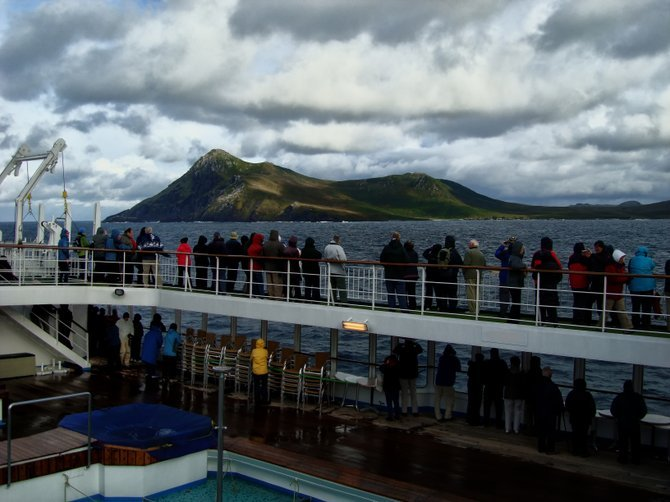 Passengers line the rail to get a first glimpse of Cape Horn.