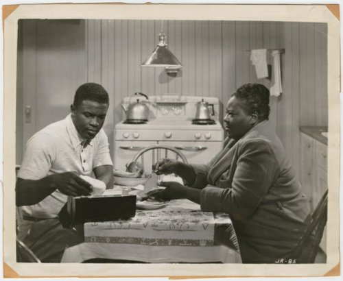 "Jackie Robinson and venerable black character actress Louise Beavers as his mother in ""The Jackie Robinson Story"" (1950)."