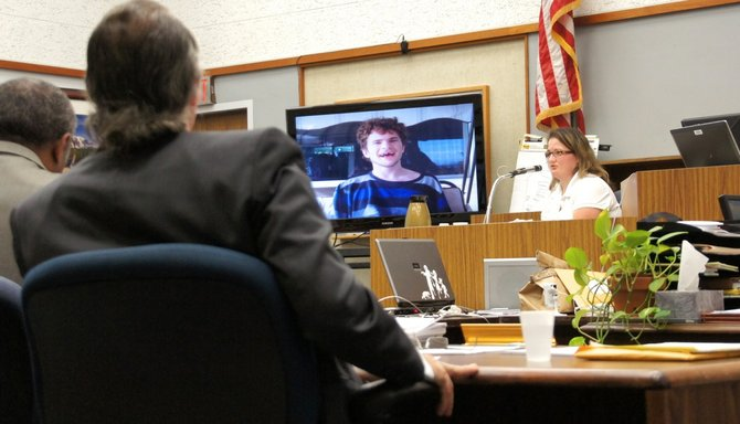Defendant listens to LVN describe her own care as appropriate.  Photo Weatherston.