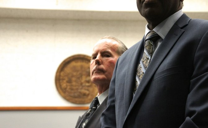 Michael Dale Garritson, 62, pleads not guilty. With defender Michael Washington. Photo Weatherston.
