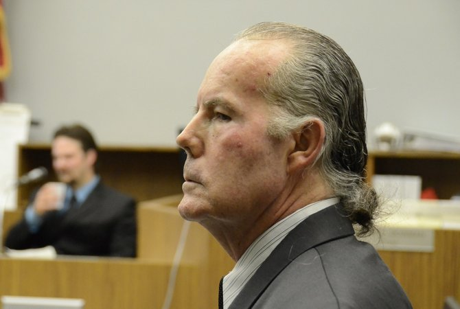 Defendant Michael Garritson, 62, and son Jarrod in the witness box.  San Diego County courtroom.  Photo Weatherston.