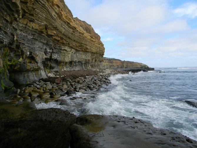 Wave beaten coastal cobbles.