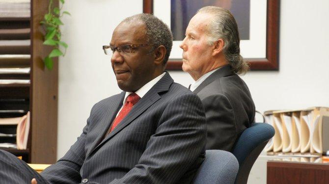 Defender Michael Washington and defendant Michael Garritson.  Photo Weatherston.