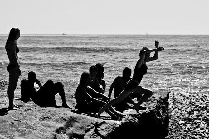 Youth being young and jumping off cliffs in Ocean Beach