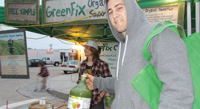Customer Matt with his $27 growler full of greens