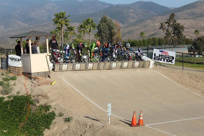 BMX racers get ready at the gate.