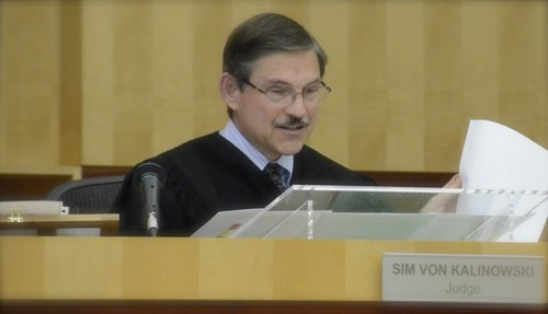 Judge Sim von Kalinowski reviewed evidence photos at hearing April 23, 2013.  Photo Weatherston.