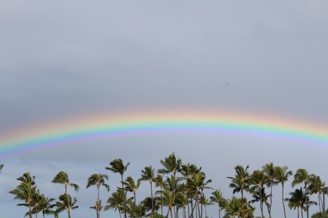 A rainbow shines through the gloom in Kapolei, Hawaii.