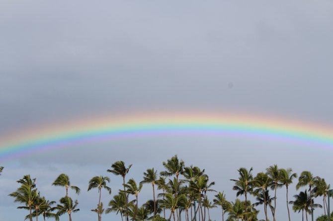 A rainbow shines through the gloom in Kapolei, Hawaii.