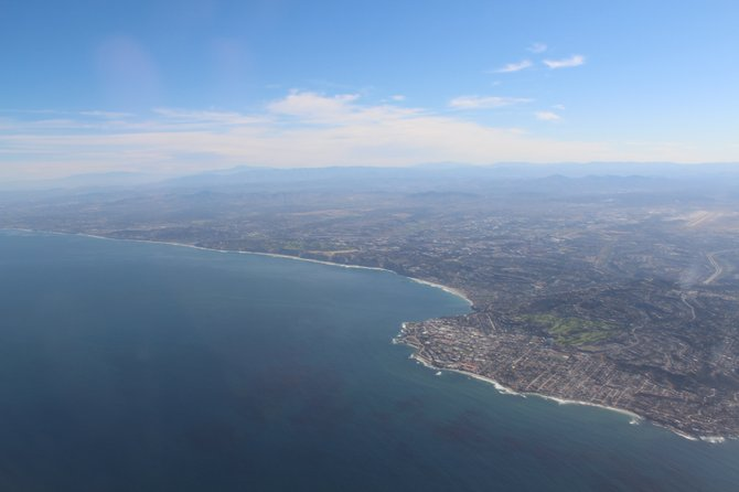 Flying over the Pacific Ocean with views of La Jolla and Torrey Pines.