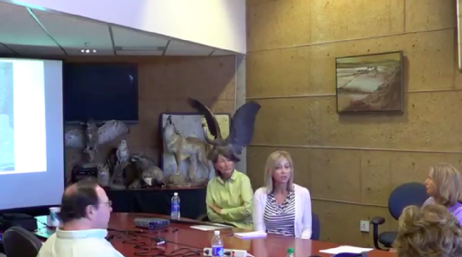 "Image from a Surfrider video taken last summer of TCA environmental director Valarie McFall (center, right) explaining to members of the public: ""[B]ecause of the controversy that this project has had, we're going beyond the [legislative] requirement and having a public review period."""