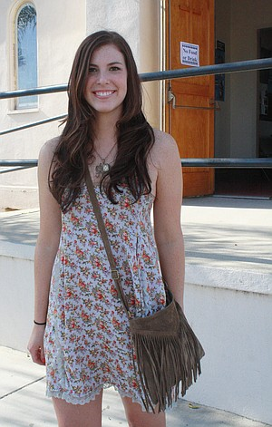 4e23c6ec2a352 Nelson wore a thrifted floral dress paired with an elephant necklace and a  Brandi Melville V-fringe brown purse ( 25).