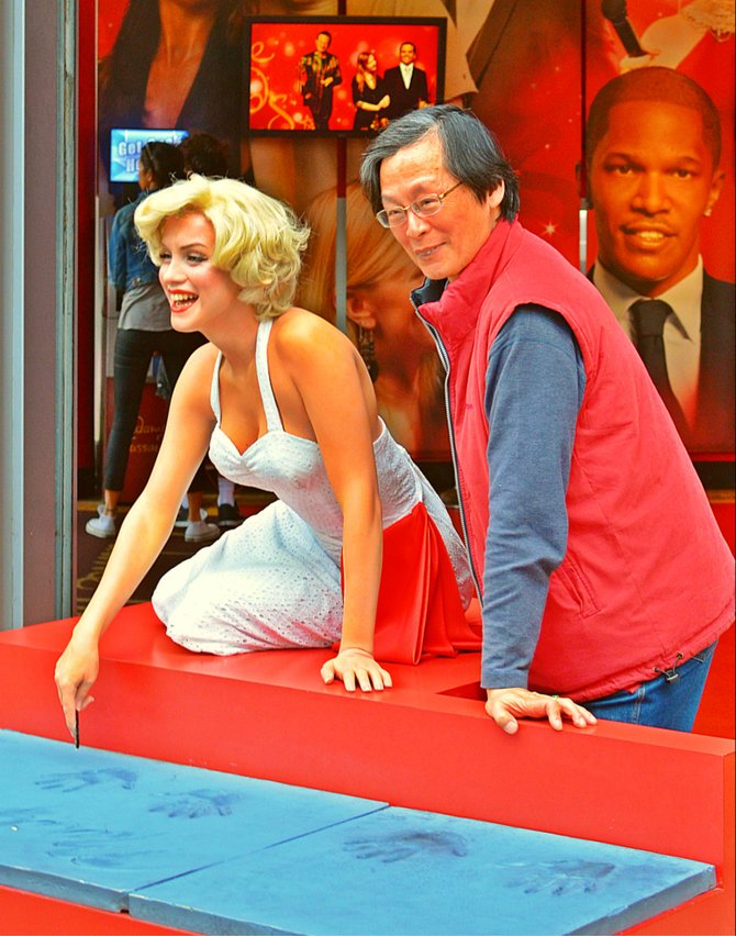posing with Marilyn on Hollywood Boulevard