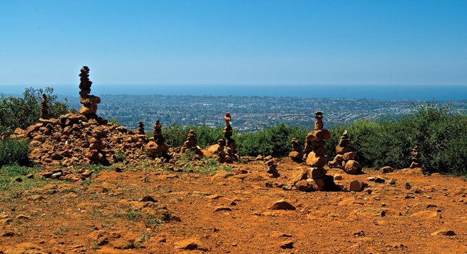 When you reach the peak, you'll find memorials of earlier ascents left by other hikers.