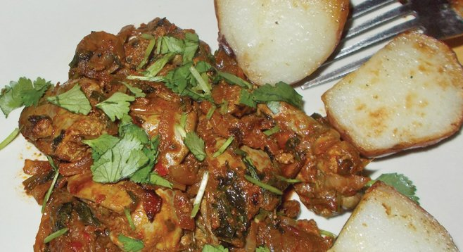 Kuchmachi is chicken liver fried with garlic, onions, cilantro, and herbs.