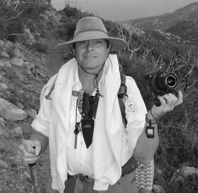 "Fine Art Photographer ""Robert Chartier"" on his never ending quest to fine natural sculptures a mile high in the Laguna Mountains. Camera in hand, on the trail."