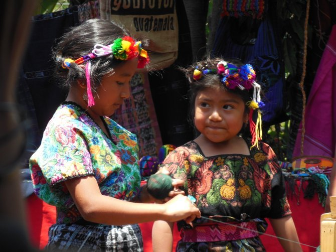 Little girls showing off their handmade homage to a rich mayan heritage in Guatemala
