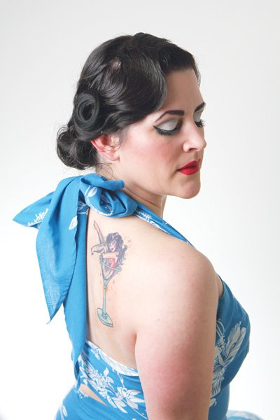 "Martini Bombshell says of burlesque, ""It still is taking your clothes off, no matter how glamorous or artistic it is."""