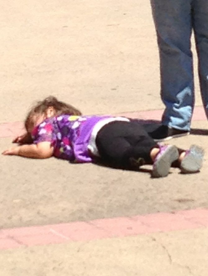 A very worn out child at Balboa Park San Diego