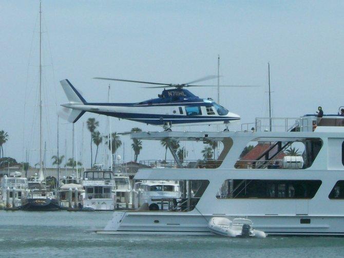 Chopper landing on yacht in San Diego Bay near Shelter Island.