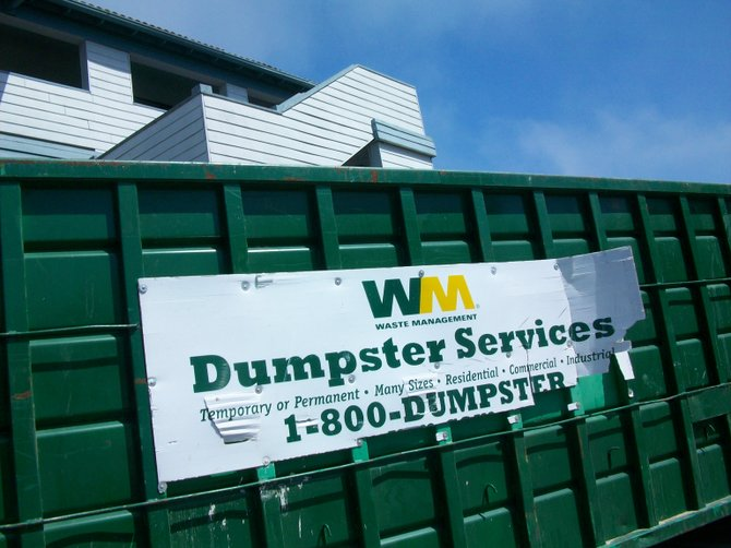 Dumpster frames the Heritage Inn in the Midway District.