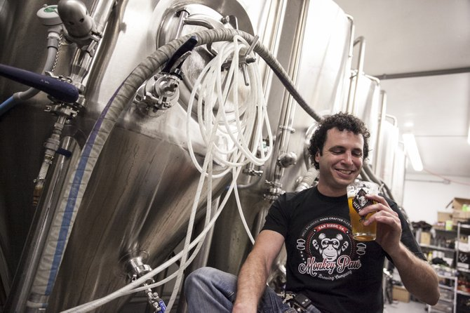 Monkey Paw Pub & Brewery's new brewmaster, Cosimo Sorrentino, enjoys the fruits of his labor