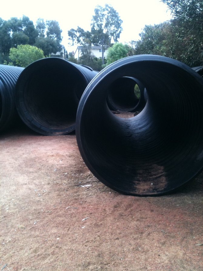 Pipes in the Park Place sit idle, due to permit screw up.