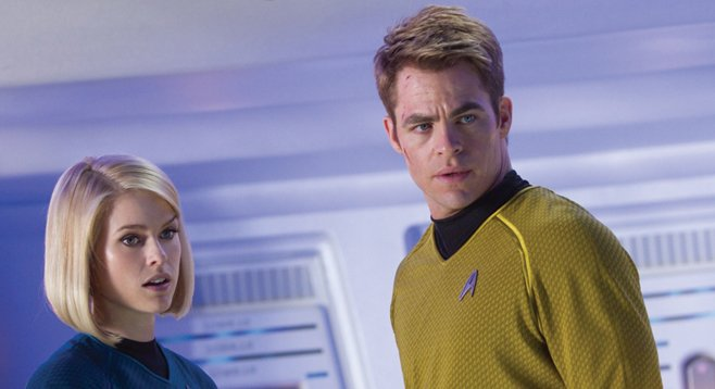 Dr. Carol Marcus and Captain Kirk react to the presence of an unattractive person onboard the Enterprise.