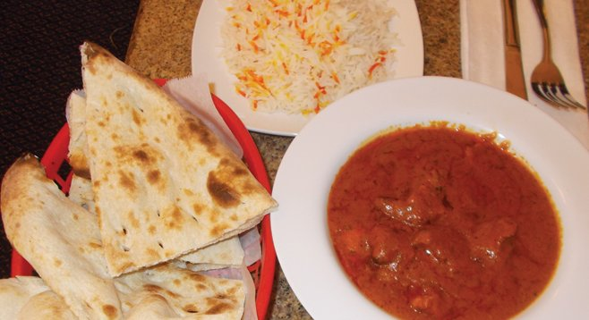 Naan bread (made in a 900-degree tandoor oven), rice, and chicken tikka masala.