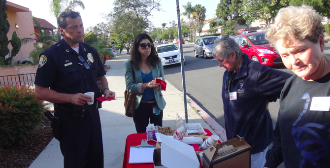 SDPD captain Andrew Mills, deputy city attorney Paige Hazard, and two University Heights Community Association volunteers
