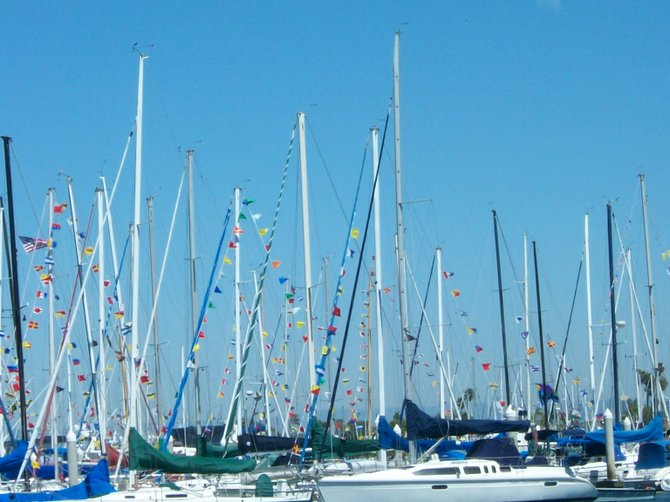 Sailing boats dressed up with regatta flags at Southwestern Yacht Club in Pt. Loma.