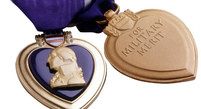 Captain Joaquin Theodore received a Purple Heart for heroism.